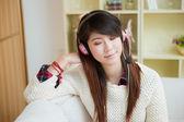 Young asian woman enjoying music — Stock Photo