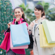 Happy Chinese women go shopping — Stock Photo