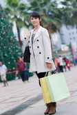 Happy Chinese woman go shopping — Stock Photo