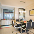 Stock Photo: Dining room and kitchen