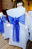 Blue ribbon chair cover — Stock Photo