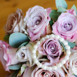 Stock Photo: Brides pink flowers and jewelry