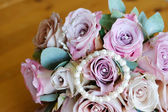 Brides pink flowers and jewelry — Stock Photo