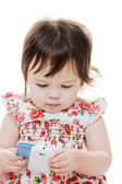 Child and cellphone — Stock Photo