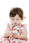 Infant girl with phone — Stock Photo