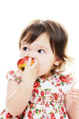 Biting red apple — Stock Photo