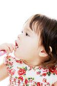 Girl cleaning teeth — Stock Photo