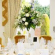 Wedding reception flower arrangement — Foto de stock #23920459