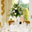 Wedding reception flower arrangement - Stock Photo