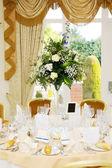 Wedding reception flower arrangement — Stock Photo