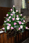 Wedding day flowers in church — Stock Photo