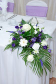 Wedding reception flowers — Stock Photo
