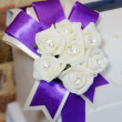 White flowers and purple ribbon — Stock Photo #31310701
