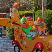 Clowns on the road — Stock Photo