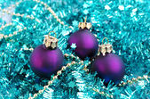 Baubles and blue tinsel — Stock Photo