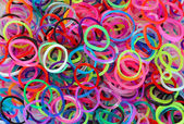 Rainbow loom rubber bands. — Stock Photo