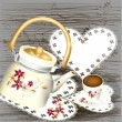 Grunge background with teapot sweets and cup of tea on a  wooden - Stockvectorbeeld