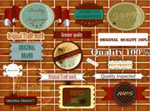 Collection of vintage labels and stikers on brick wall — Stock Vector