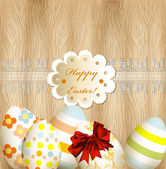 Easter greeting card with eggs, lace and banner on wooden backgr — Stock Vector