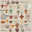 Collection of vector heraldic fleur de lis and crowns — Stock Vector #28187015