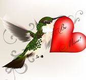 Beautiful humming bird holding a big red heart with signature be — Vector de stock