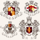 Collection of vector heraldic shields in vintage style — Stock Vector