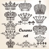 Set of vector hand drawn crowns  for design — Stock Vector