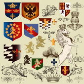 Collection of  vector heraldic decorative elements fleur de lis, — Stock Vector