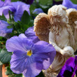 Stock Photo: Angel Statue in Pansies