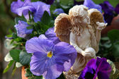 Angel Statue in Pansies — Stock Photo
