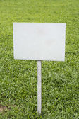 Blank signpost in green grassland — Stock Photo