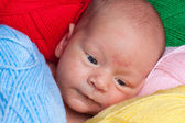 Baby in yarn — Stock Photo