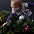 Girl with christmas toy — Stockfoto