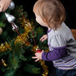 Girl with christmas toy — Stock Photo #16323477