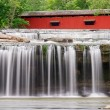 Waterfall and Covered Bridge — Stock Photo