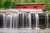 Waterfall and Covered Bridge — Stock Photo