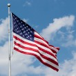 US Flag Waving in Blue Cloudy Sky — Stock Photo