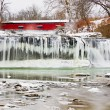 Red Covered Bridge and Frozen Waterfall — Stock Photo #40652065
