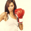 Attractive woman wearing boxing gloves — Stock Photo