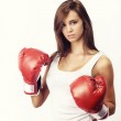 Attractive woman wearing boxing gloves — Stock Photo #12326876