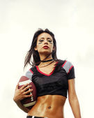 Beautiful sexy woman in football top holding ball — Stock Photo