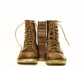 Holy bible and rugged boots — Stock Photo