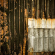 Partially rustic galvanized sheet wall and nail — Stock Photo