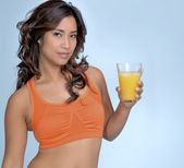 Young woman with orange juice — Stock Photo