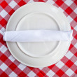 Table cloth with plate and cutlery — Stock Photo