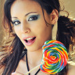 Stock Photo: Womholding colorful candy lollypop