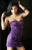 Young woman wearing purple dress — Stock Photo