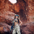 Beautiful army girl in red rock location — Stock Photo
