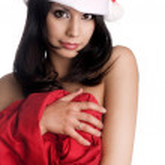 Sweet beautiful young woman wearing Santa Clause hat — Stock Photo