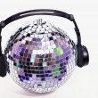 Disco ball with head phones — Stock Photo